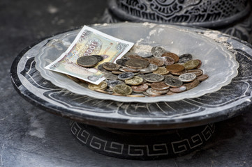 Vietnamese money in a bowl