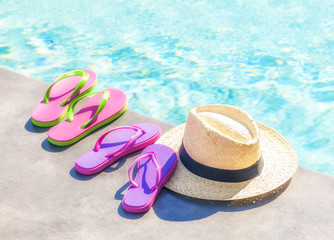 Sandals and hat at the pool