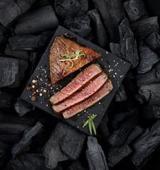 juicy grilled steak on a black slate.