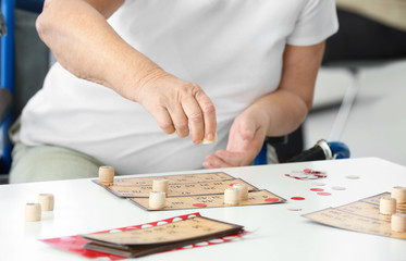 Senior woman playing lotto at care home, closeup