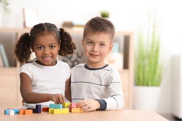Little kids playing indoors. Child adoption