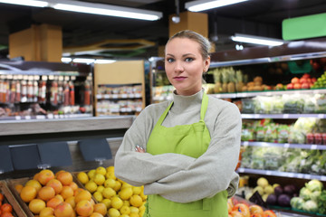 Portrait of young woman in shop. Small business owner