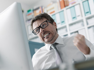 Angry business executive having computer problems