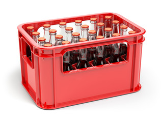 Bottles with soda or cola in the red strage crate for bottles.
