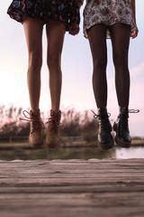 Crop women legs on wood jumping
