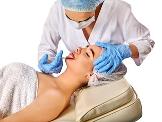 Filler injection for female forehead face. Plastic aesthetic facial surgery in beauty clinic. Beauty woman giving injection.
