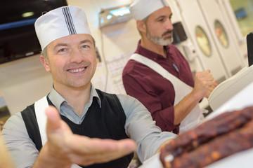 happy butcher in shop