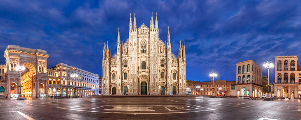 Panoramic view of piazza del Duomo, Cathedral Square, with Milan Cathedral or Duomo di Milano, Galleria Vittorio Emanuele II and Arengario, during morning blue hour, Milan, Lombardia, Italy