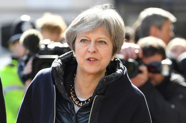Britain's Prime Minister Theresa May visits the city where former Russian intelligence officer Sergei Skripal and his daughter Yulia were poisoned with a nerve agent, in Salisbury