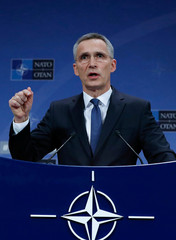 NATO Secretary-General Jens Stoltenberg addresses a news conference at the Alliance headquarters in Brussels