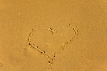 Shape of heart on the sandy beach