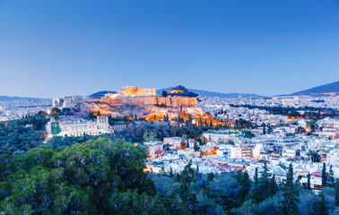 Athens, Greece, iconic landmark Parthenon. Panoramic view of Athens skyline. Lovely twilight view on ancient landmark Parthenon in Athens, Greece.