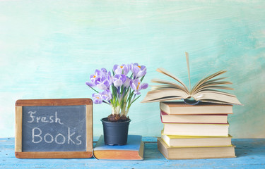 Open book and a blackboard advertising the fresh books of the new season