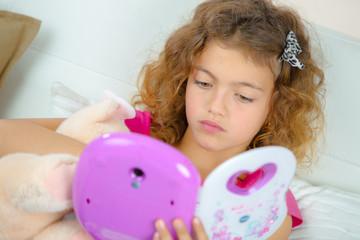 Fototapeta girl playing with electronic toy obraz