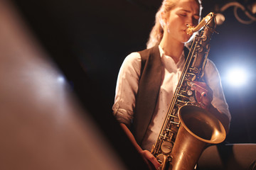 The girl playing the saxophone