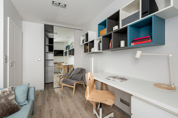 White desk, chair and bookshelves