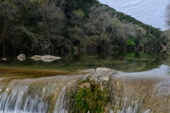 A view of Barton Creek Greenbelt Trail in Austin TX with Twin falls and Sculpture falls.