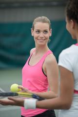 female tennis players after tennis match