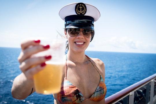 Woman drinking beer at cruise ship