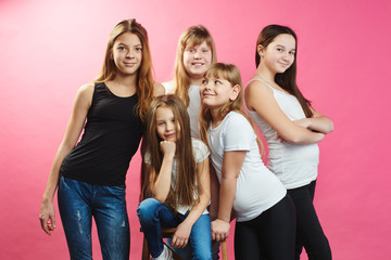 A group of teen girls on a pink background