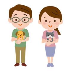 ペットを抱っこする男女