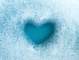 Heart shape formed from soap suds