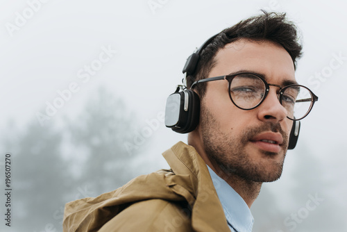95f27c430ff Horizontal close up portrait of handsome smart young Caucasian male wearing  eyeglasses
