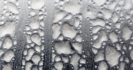 Black and white drawings on the glass in the frost