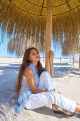 Fototapete - young woman in a beach under parasol