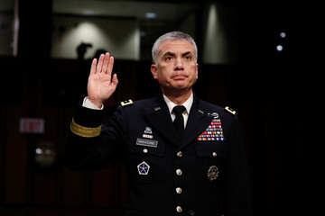 Lieutenant General Paul Nakasone, nominee to lead the National Security Agency and US Cyber Command, is sworn in before the Senate Intelligence Committee on Capitol Hill in Washington
