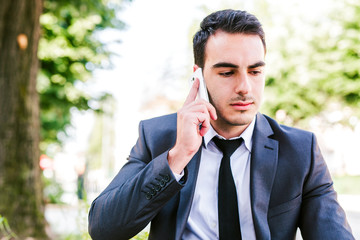 Young businessman talking on cellphone