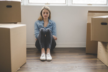 A woman with box at home