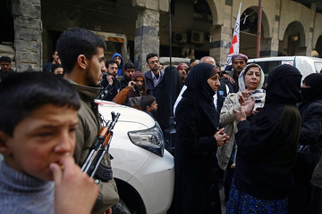 People are seen in the besieged town of Douma, Eastern Ghouta, in Damascus