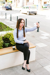 Young businesswoman take selfie
