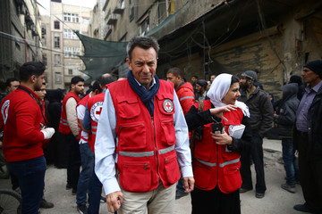 President of the International Committee of the Red Cross Peter Maurer is seen in the besieged town of Douma, Eastern Ghouta, in Damascus