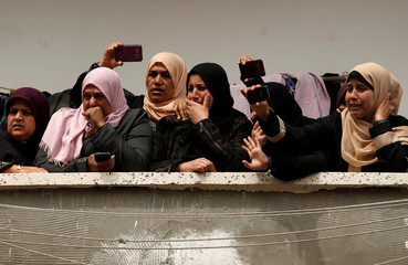Relatives of Palestinian fisherman Ismail Abu Riyalah grieve for him at his funeral in Gaza City