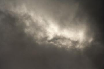 Gray rain clouds. Dark stormy sky background