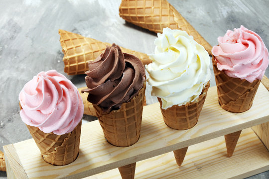 Vanilla frozen yogurt or soft ice cream in waffle cone.