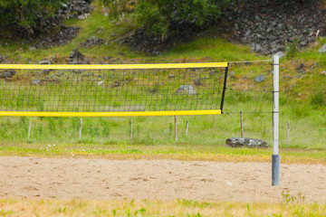 volleyball yellow net and playing court outdoor