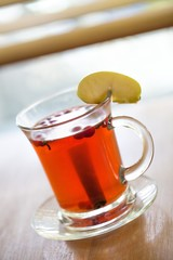 Drink with Apple and Cinnamon Stick