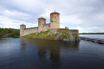 View of the Olavinlinna fortress on a cloudy June evening. Savonlinna, Finland