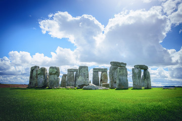 Wall Mural - Stonehenge an ancient prehistoric stone monument on blue sky in Wiltshire, UK.