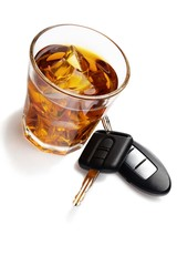 glass of liquor with car key