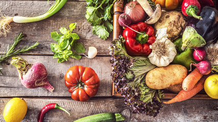 Wall Mural - Organic vegetables healthy nutrition concept on wooden background