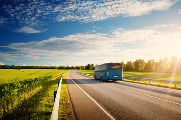 Wall Mural - Bus on asphalt road in beautiful spring day at countryside
