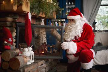 Santa Claus, indoors, putting log on fire