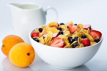 Bowl of Cornflakes, Blueberries, Strawberries and Milk