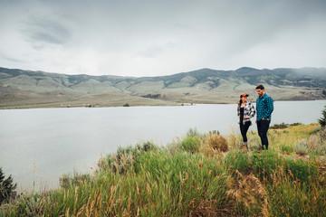 Couple walking near Dillon Reservoir, Silverthorne, Colorado, USA