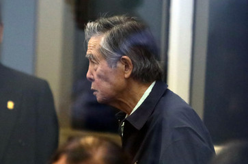 Former President of Peru Alberto Fujimori attends a trial as a witness at the navy base in Callao