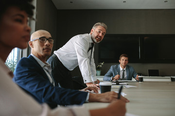 Business group having discussion at office meeting